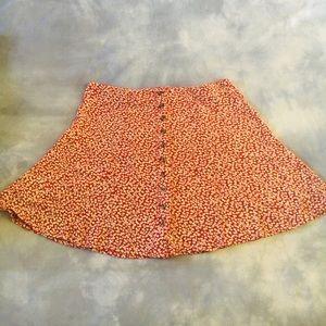 American Eagle red flowery short skirt.